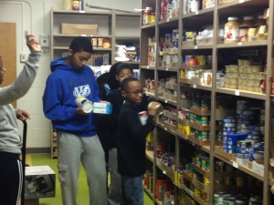 OSBC Members Stocking Christ Child Food Pantry (11/27/13)